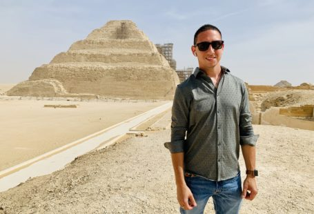 Visiting Saqarra, standing in front of the famous step pyramid