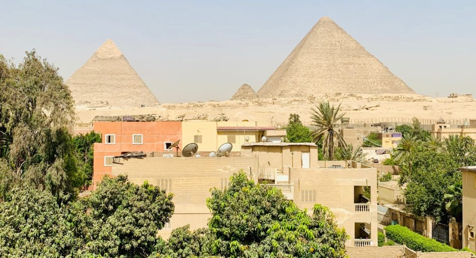 Waking up in Giza, rooftop view of the Great Pyramids of Giza